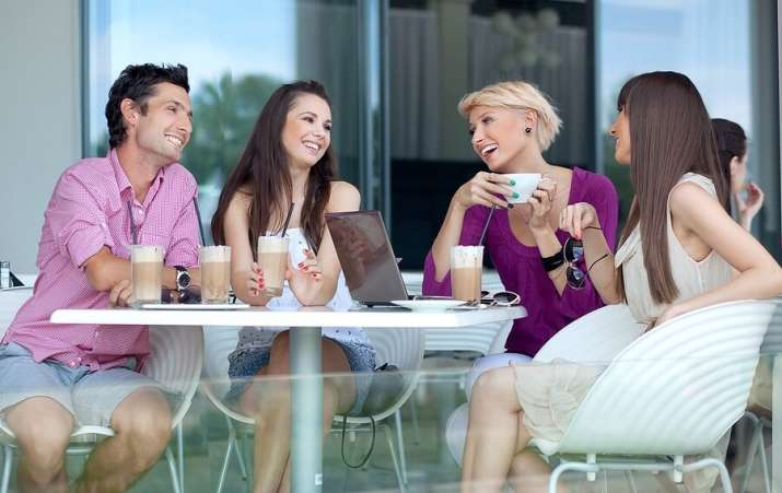 Group of young adults drink coffee