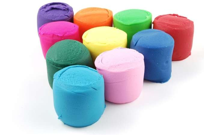Colored play dough on white background