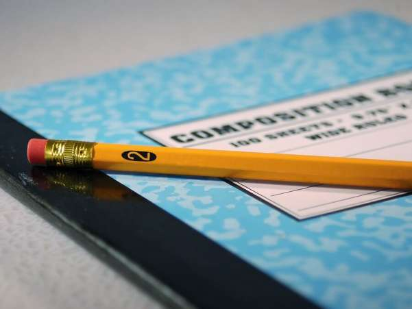 Composition book and pencil
