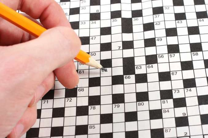Doing a crossword puzzle