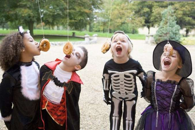 four friends eating donuts on a string - Halloween Party Games Toddlers