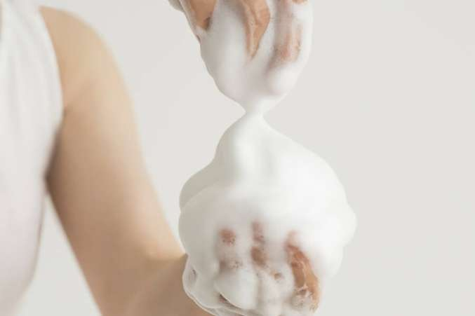 Pile of soapy foam in hands