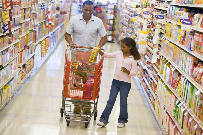 Tips for Learning Outside of School, Dad and girl grocery shopping together as learning activity