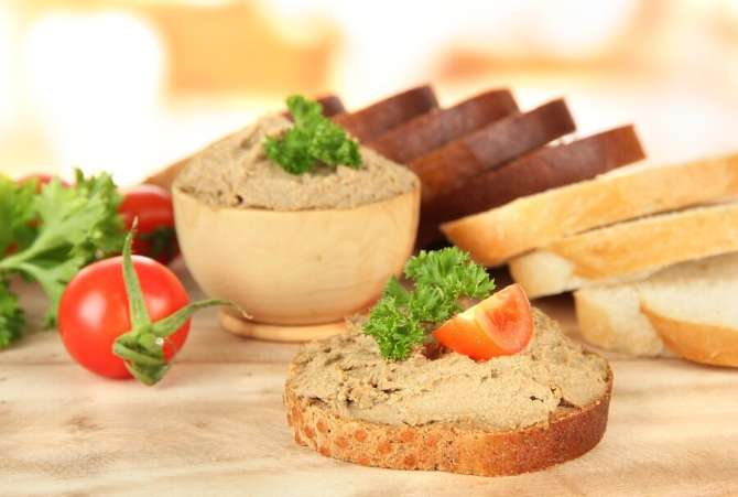 Fresh pate on bread with tomatoes