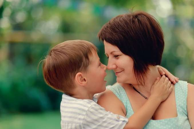 Happy mother and young son hugging