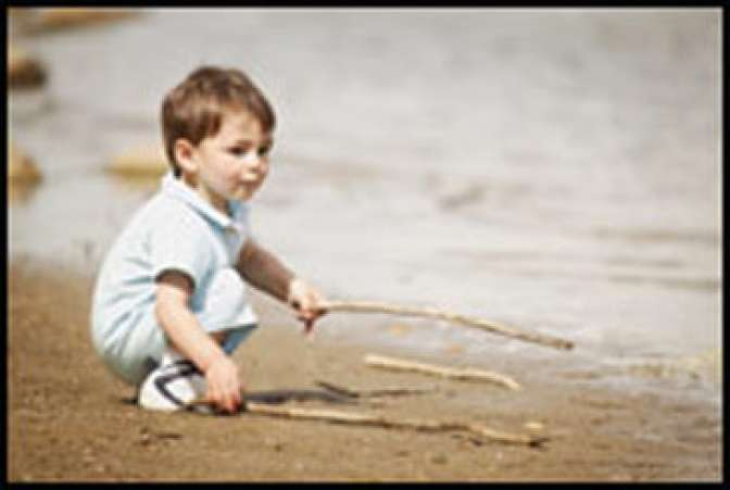 Boy playing with sticks