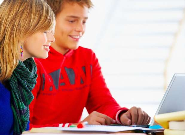 Young kids using computer