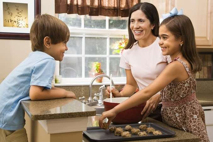 Mom and kids in kitchen making cookies