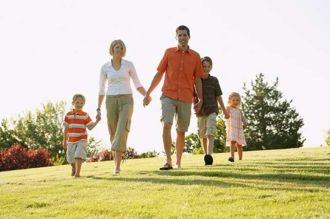 Family of four taking walk in nice weather