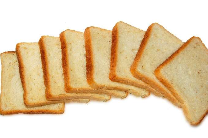 Sliced white bread against white backdrop