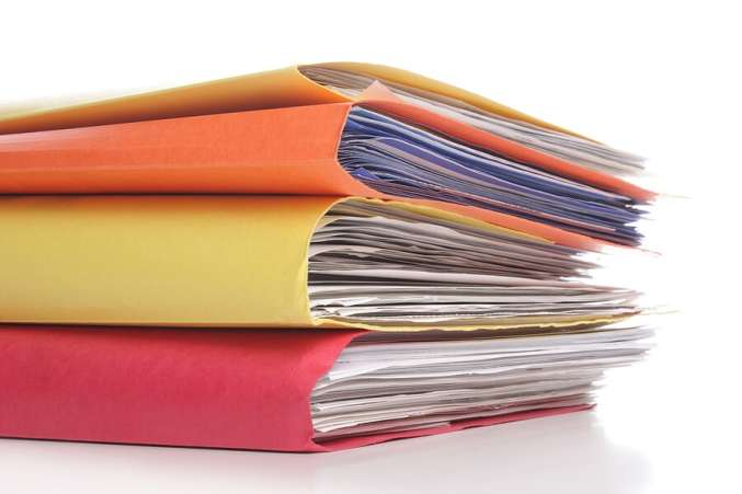 StackofColorfulFoldersFilledwithPaper