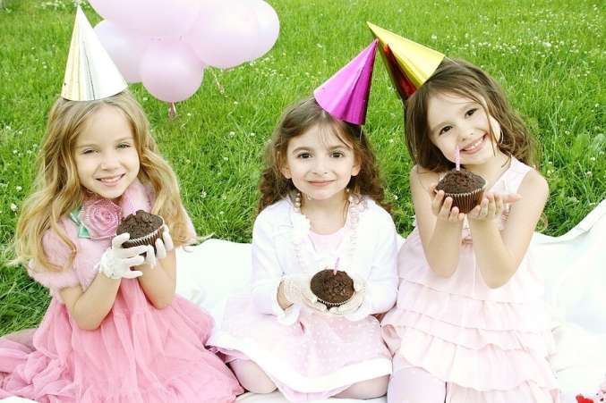 Little girls dressed up at birthday party