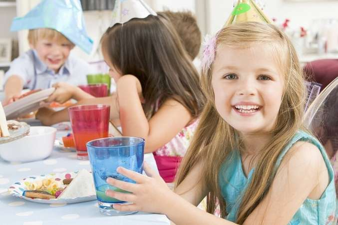 Smiling girl at birthday party table