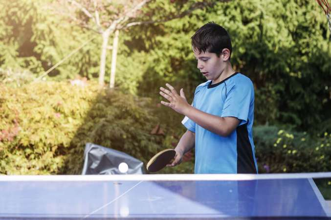 boy playing ping-pong