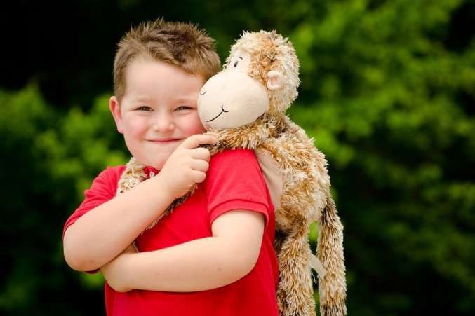 boy with stuffed animal lovey