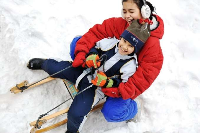 traditional christmas activity, kids sledding