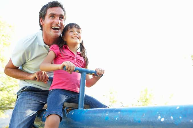 Fun Family Fitness, Father and daughter on seesaw at playground
