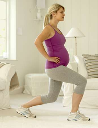 Pregnant woman doing lunges