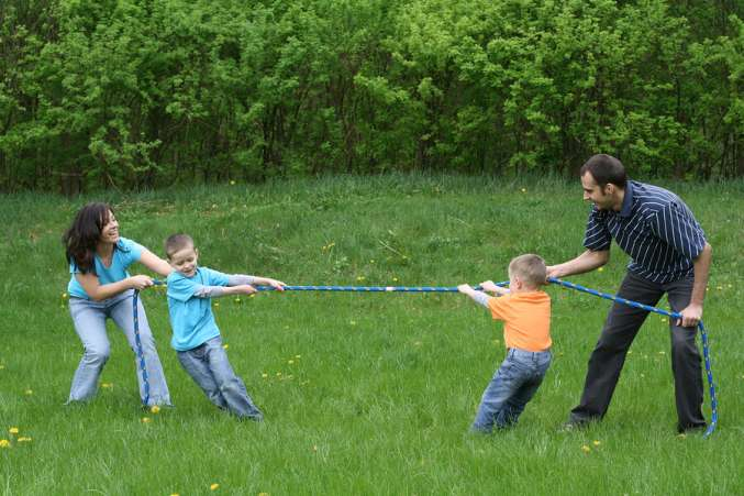 family playing tug o' war