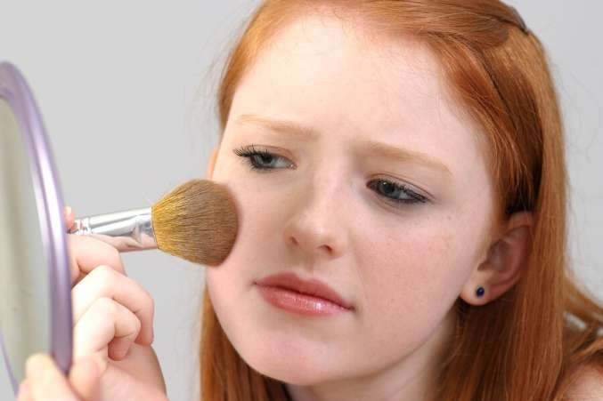 what is the right age, girl applying makeup