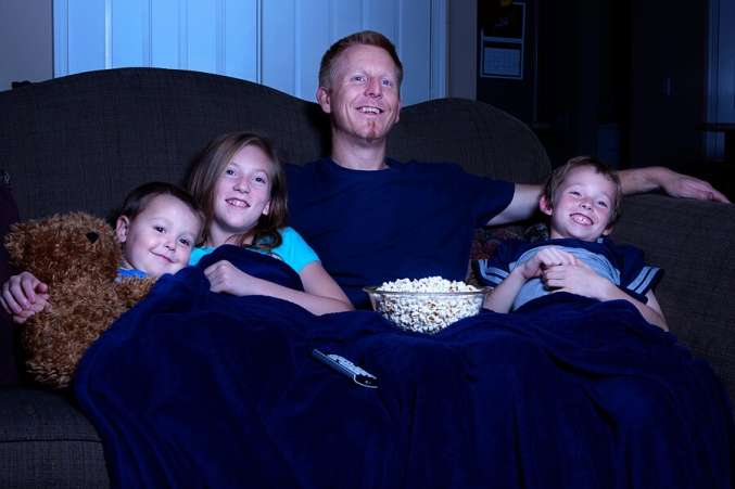 traditional christmas activity, dad and kids watch movies
