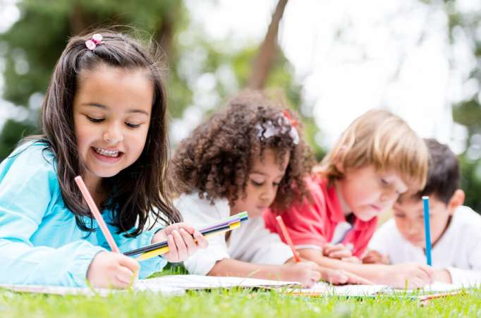 kids drawing outdoors