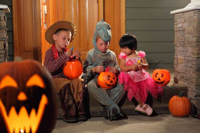 Halloween safety tip, kids sorting Halloween candy