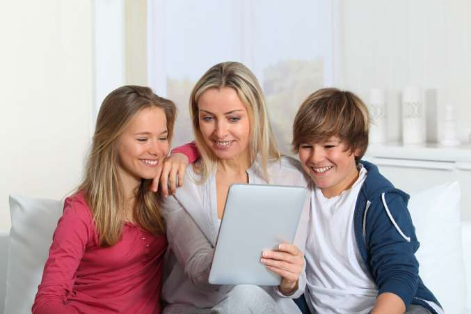 mother and teens using tablet