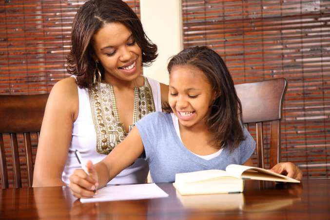 Homework help, mother helping tween daughter