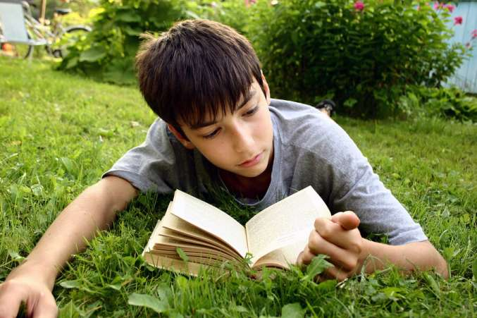 shy teen boy reading