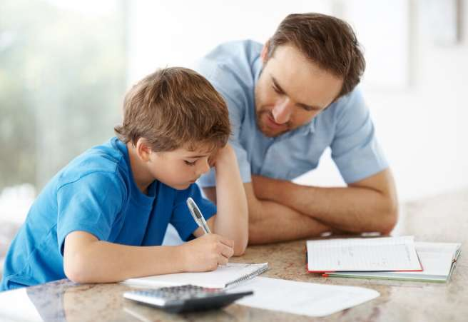 Homework help, father helping son