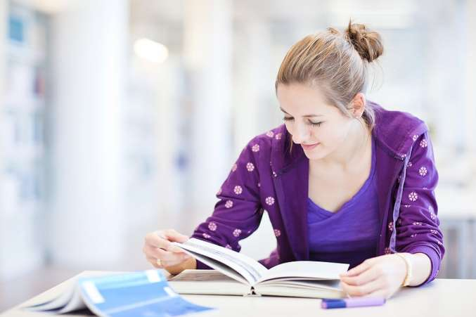 what colleges look for, female high school student studying for test