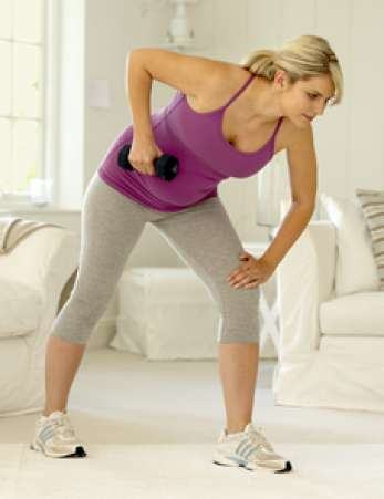 Pregnant woman using dumbbells