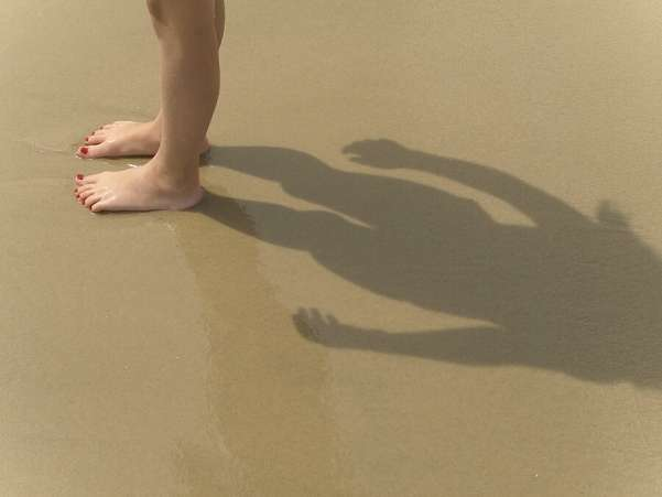 Summer Science for Kids, Child on beach learns about her shadow