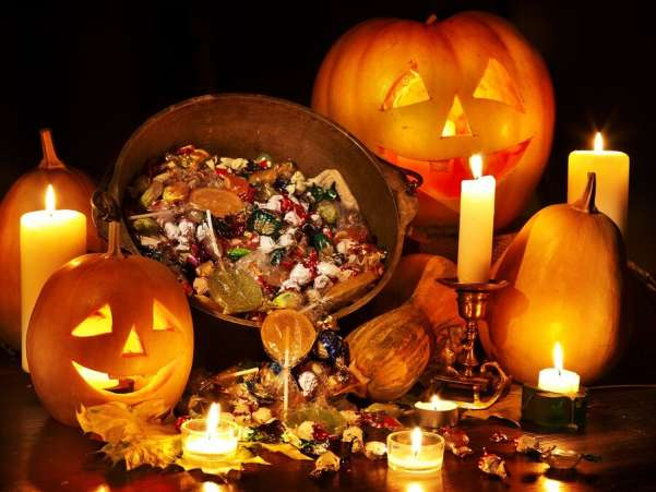 halloween candy and carved pumpkins - The Tradition Of Halloween