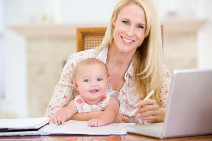 Working mom on laptop with baby on lap