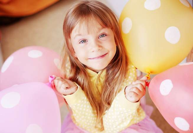 birthday child with balloons