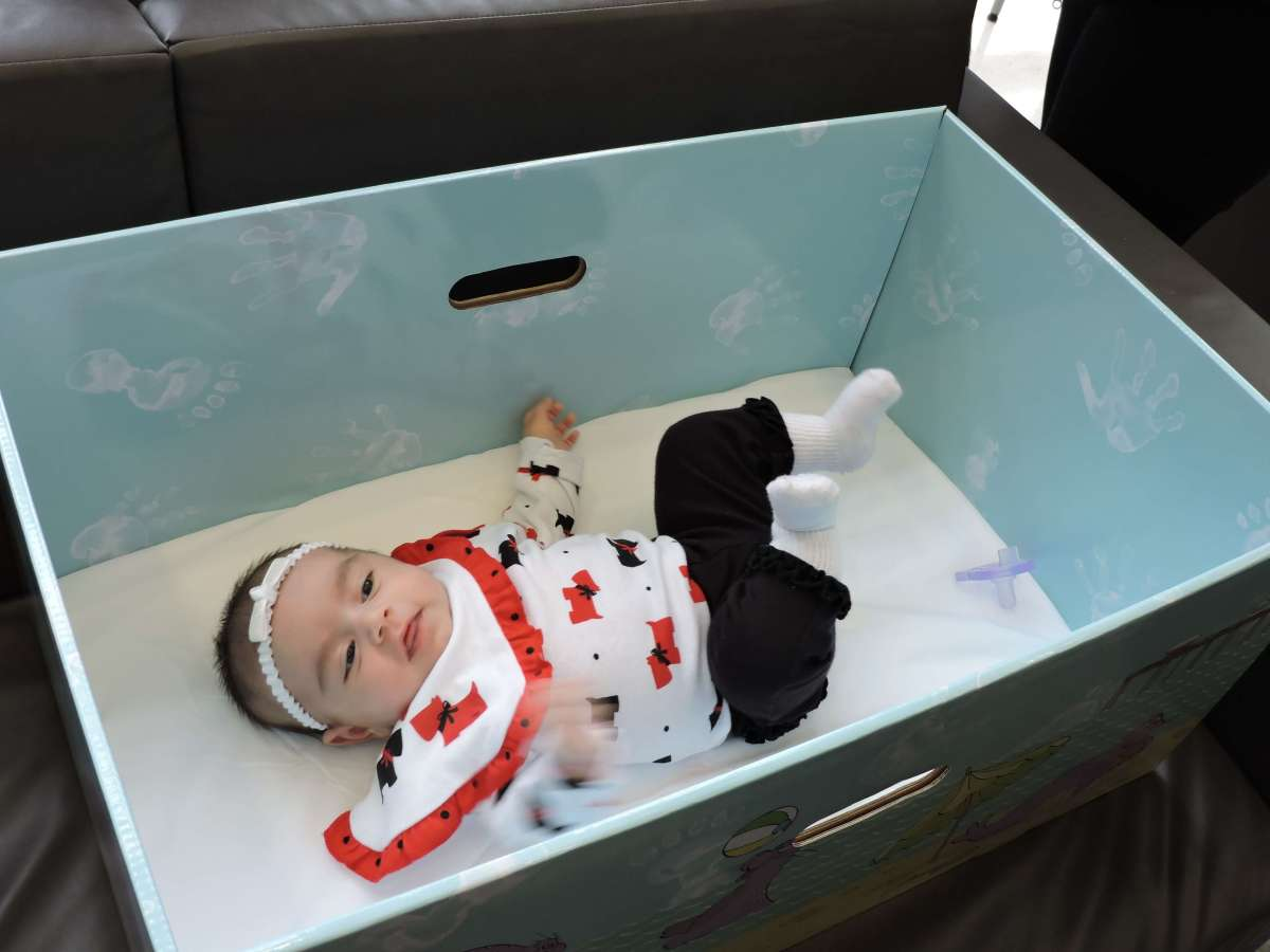 Baby Sleeping in a Box