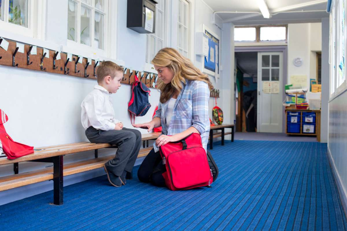 child being disciplined at school