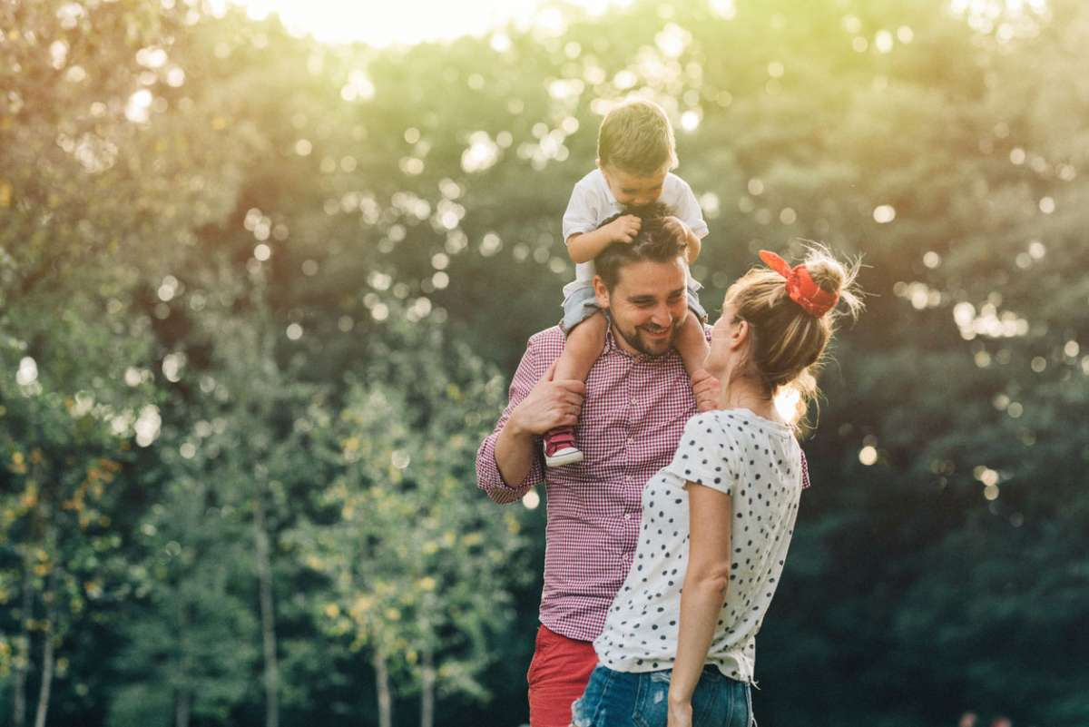 couple in love with son having fun in park