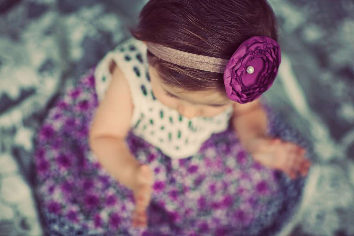 baby wearing purple outfit and diy headband