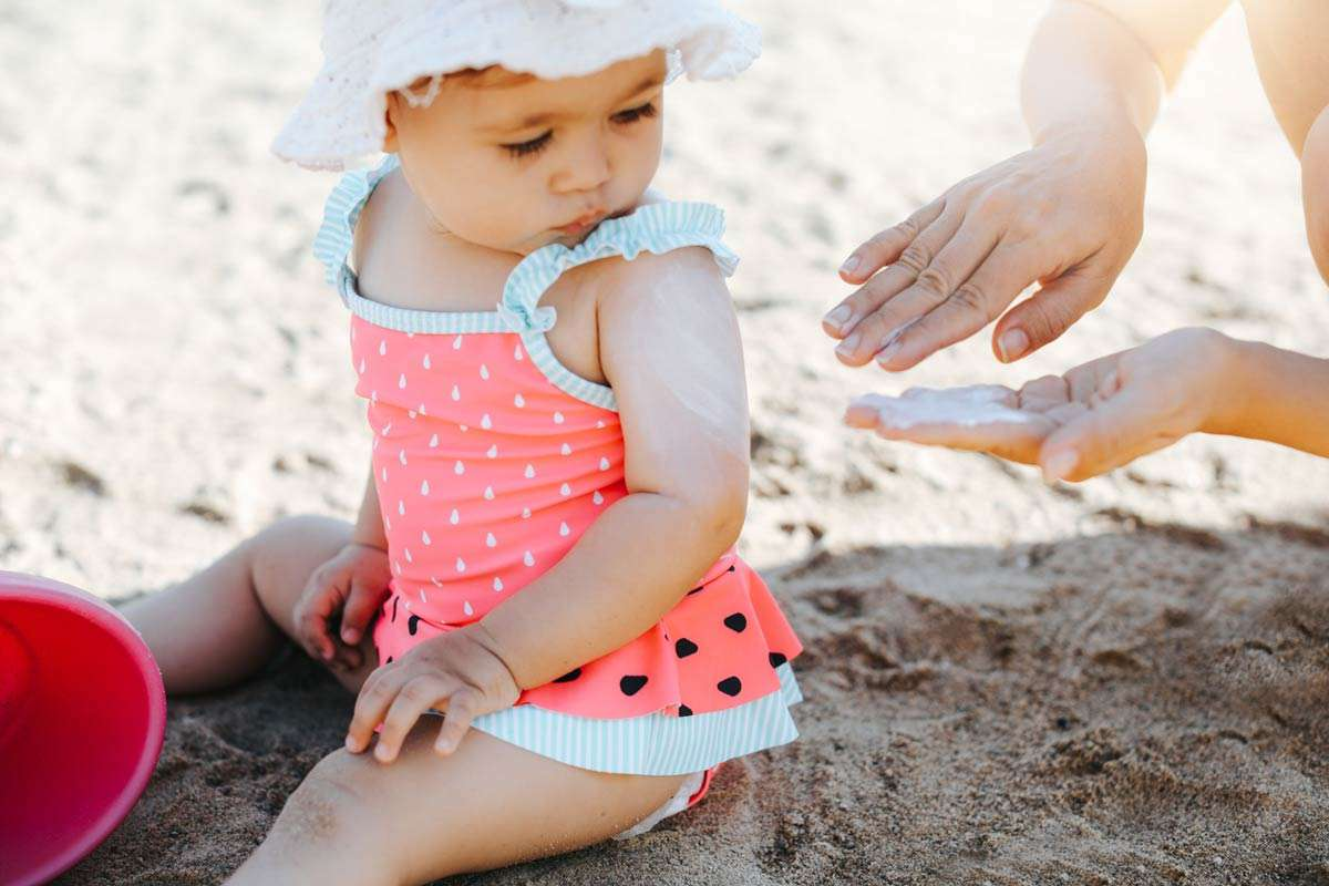 mom following sunscreen guidelines for babies