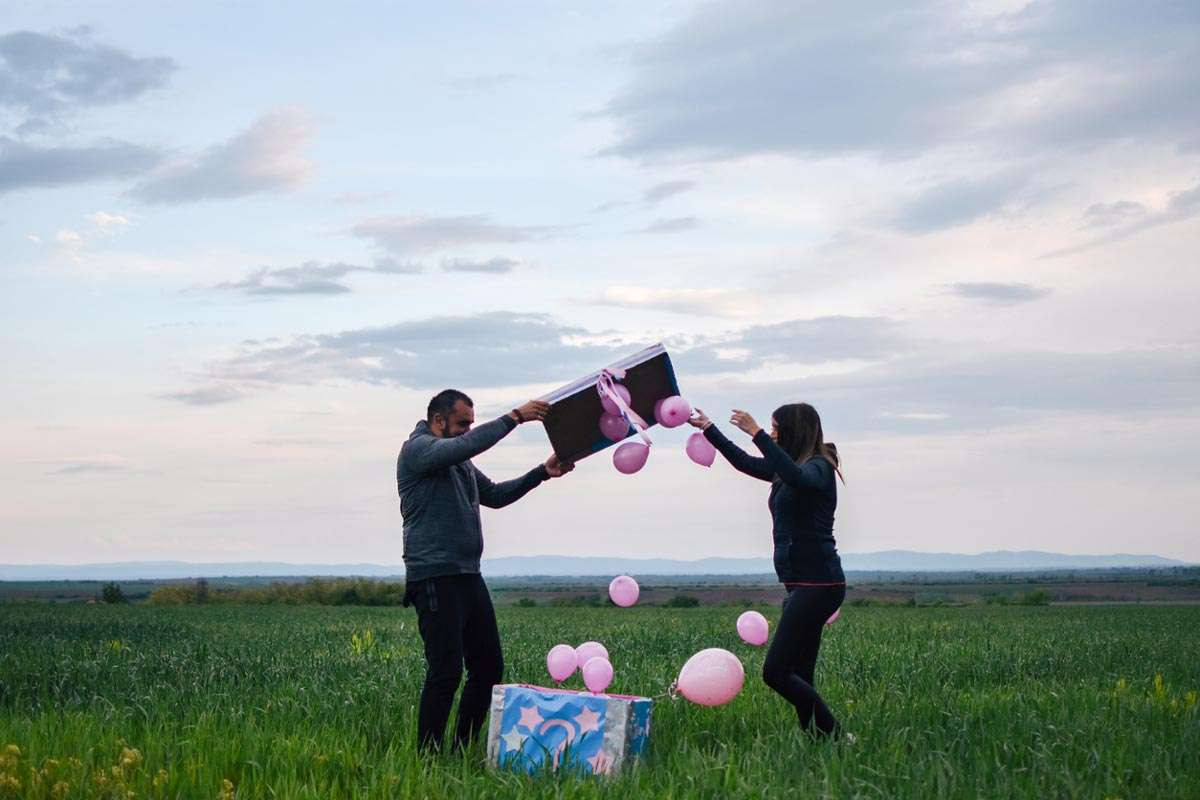 family having a gender reveal party