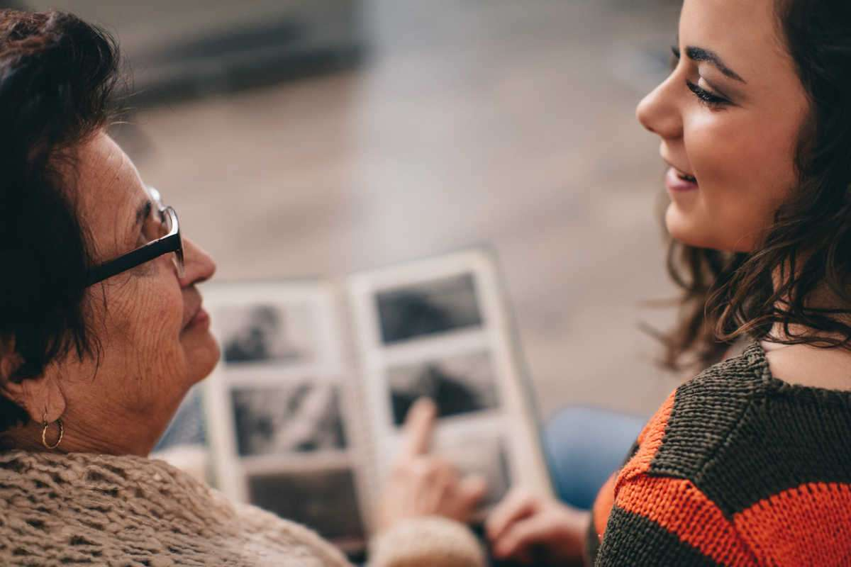 woman talking to grandma about family health history
