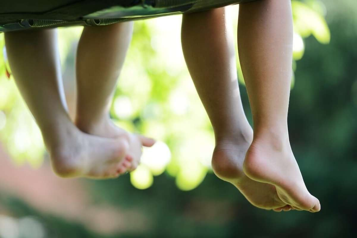 Children's feet dangling from hammock