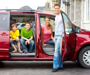 Tips for Road Trips and Car Travel with Kids, family of four ready for road trip in minivan