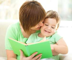Mother reading book to her son