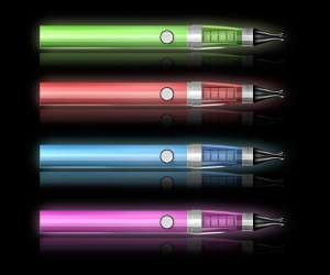 Colorful e cigarettes on black background