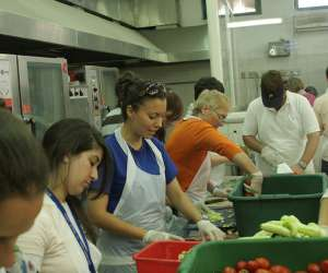teens volunteering in soup kitchen