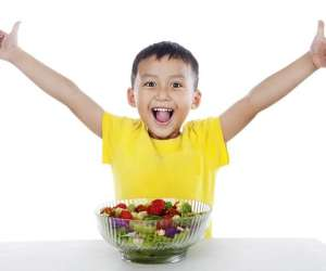 Happy Child Eating Salad